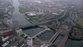 AX113_106 - 6K stock footage aerial video fly over bridges spanning River Lagan, Belfast, Northern Ireland