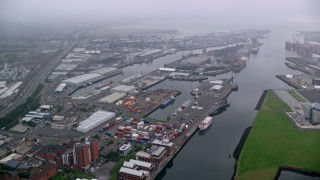 AX113_107 - 6K stock footage aerial video of approaching the Port of Belfast and River Lagan, Northern Ireland