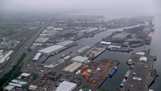 AX113_108 - 6K stock footage aerial video flyby Port of Belfast toward M2 Freeway, Northern Ireland