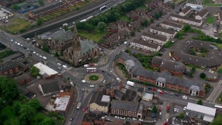 AX113_110 - 6K stock footage aerial video of orbiting the Carlisle Circus roundabout by a church in Belfast, Northern Ireland
