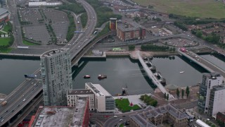 AX113_118 - 6K stock footage aerial video of Queen's Bridge and M3 Highway over River Lagan, Belfast, Northern Ireland