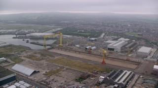 AX113_120 - 6K stock footage aerial video of cranes at the Port of Belfast, Northern Ireland