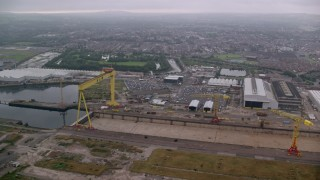 AX113_121 - 6K stock footage aerial video of orbiting cranes at the Port of Belfast, Northern Ireland
