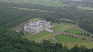AX113_124 - 6K aerial stock footage video of Parliament Buildings, grounds and trees, Belfast, Northern Ireland
