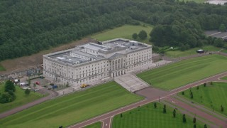 AX113_125 - 6K stock footage aerial video flyby Parliament Buildings and grounds, Belfast, Northern Ireland