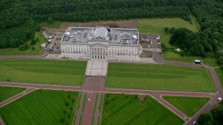 AX113_126 - 6K stock footage aerial video of orbiting Parliament Buildings and the grounds around it, Belfast, Northern Ireland