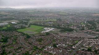 AX113_127 - 6K stock footage aerial video of flying by residential neighborhoods, Belfast, Northern Ireland