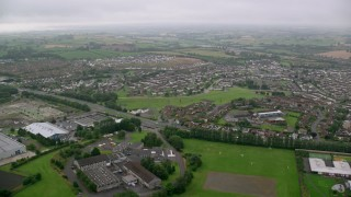 AX113_128 - 6K stock footage aerial video of passing by residential neighborhoods, Belfast, Northern Ireland