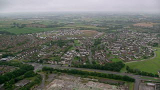 AX113_129 - 6K stock footage aerial video of residential neighborhoods and countryside, Belfast, Northern Ireland
