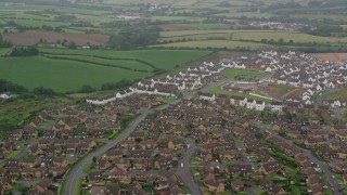 AX113_130 - 6K stock footage aerial video of neighborhoods on the outskirts of Belfast, Northern Ireland