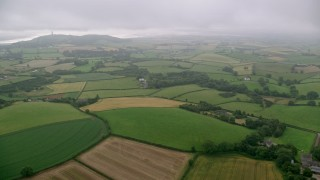 AX113_131 - 6K stock footage aerial video of flying over farms and farmland toward Scrabo Tower, Newtownards, Northern Ireland