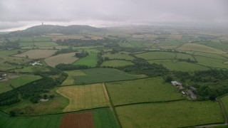 AX113_132 - 6K stock footage aerial video of farms and farm fields on the way to Scrabo Tower, Newtownards, Northern Ireland