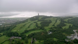 AX113_135 - 6K stock footage aerial video of flying over Scrabo Golf Club toward Scrabo Tower, Newtownards, Northern Ireland