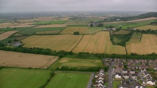 AX113_138 - 6K stock footage aerial video of farms and farming fields, Newtownards, Northern Ireland