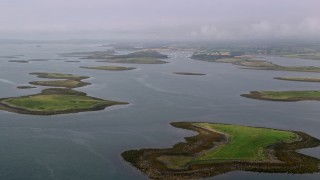 AX113_141 - 6K stock footage aerial video of an approach to islands in a sea loch, Strangford Lough in Northern Ireland
