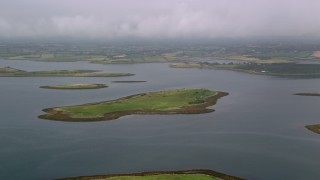 AX113_142 - 6K stock footage aerial video of flying by islands in a sea loch, Strangford Lough, Northern Ireland