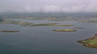 AX113_143 - 6K stock footage aerial video flyby islands in a sea loch, Strangford Lough, Northern Ireland