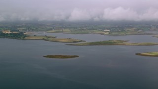 AX113_144 - 6K stock footage aerial video of islands in a sea loch and farmland on the shore, Strangford Lough, Northern Ireland