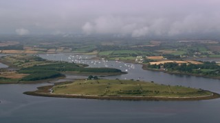 AX113_145 - 6K stock footage aerial video of islands and a harbor in Strangford Lough, Northern Ireland