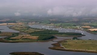 AX113_146 - 6K stock footage aerial video of passing islands and a harbor in Strangford Lough, Northern Ireland