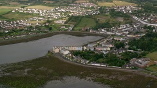 AX113_152 - 6K stock footage aerial video of waterfront homes and fields, Strangford Lough, Killyleagh, Northern Ireland