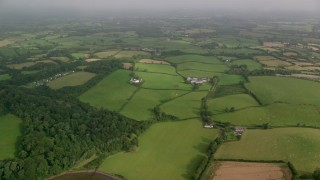 AX113_156 - 6K stock footage aerial video of a vast rural landscape of farm fields, Killyleagh, Northern Ireland