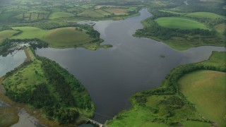 AX113_158 - 6K stock footage aerial video of Strangford Lough and green shores, Downpatrick, Northern Ireland