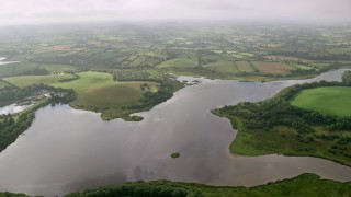 AX113_159 - 6K stock footage aerial video of farms on the shoes of Strangford Lough, Downpatrick, Northern Ireland