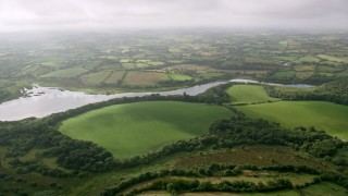 AX113_160 - 6K stock footage aerial video of farmland along the Quoile River, Downpatrick, Northern Ireland