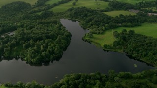 AX113_161 - 6K stock footage aerial video of trees and farmland along the Quoile River, Downpatrick, Northern Ireland
