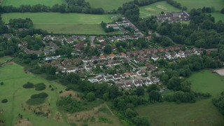AX114_001 - 6K stock footage aerial video of homes in a village, Banstead, England