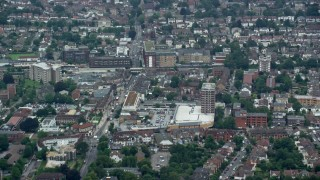 AX114_006 - 6K stock footage aerial video of apartment buildings and shopping center, Wallington, England