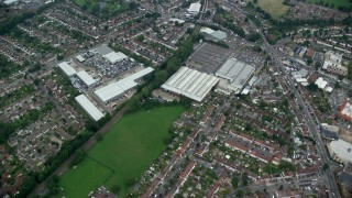 AX114_007 - 6K stock footage aerial video fly over residential neighborhoods and a shopping center, Croydon, England