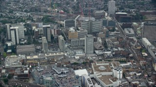 AX114_009 - 6K stock footage aerial video of flying past the Centrale shopping mall and office buildings, Croydon, England