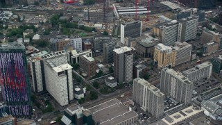 AX114_010 - 6K stock footage aerial video of flying past office buildings, Croydon, England