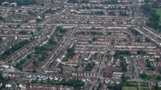 AX114_011 - 6K stock footage aerial video orbit row houses in residential neighborhood, Thornton Heath, England
