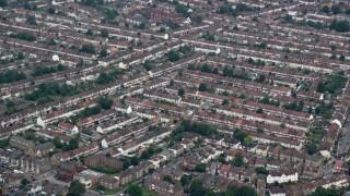 AX114_012 - 6K stock footage aerial video row houses in Thornton Heath, England