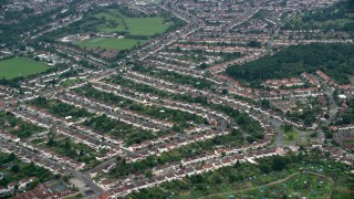 AX114_014 - 6K stock footage aerial video of passing by residential neighborhoods, Thornton Heath, England