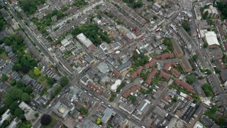 AX114_015 - 6K stock footage aerial video tilt to bird's eye of residential neighborhoods and streets, London, England