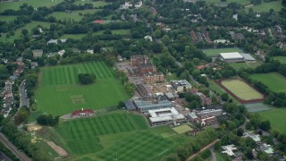 AX114_016 - 6K stock footage aerial video approach Dulwich College in London, England
