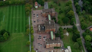 AX114_017 - 6K stock footage aerial video tilt to a bird's eye view of Dulwich College, London, England