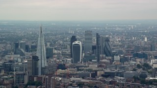 AX114_019 - 6K stock footage aerial video approach The Shard Central and skyscrapers in Central London, England