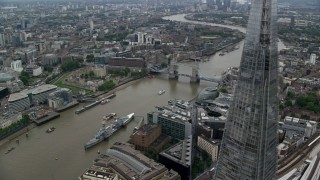 AX114_023 - 6K stock footage aerial video of flying by The Shard skyscraper for view of Tower Bridge, London, England