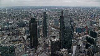 AX114_025 - 6K stock footage aerial video of tall skyscrapers and vast cityscape, Central London, England