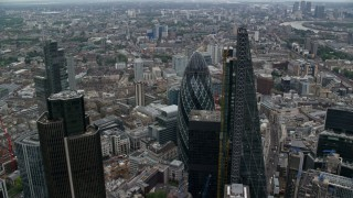 AX114_026 - 6K stock footage aerial video orbit tall skyscraper to reveal The Gherkin, Central London, England