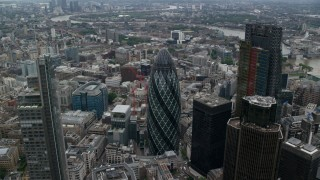 AX114_027 - 6K stock footage aerial video orbiting The Gherkin and neighboring skyscrapers, Central London, England