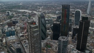 AX114_028 - 6K stock footage aerial video of orbiting The Gherkin and Heron Tower skyscrapers, Central London, England