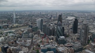 AX114_031 - 6K stock footage aerial video of an orbit of skyscrapers, The Shard in the distance, Central London, England