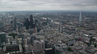 AX114_043 - 6K stock footage aerial video of Central London city sprawl and skyscrapers near River Thames, England
