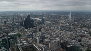 AX114_044 - 6K stock footage aerial video of Central London skyscrapers, The Shard and city sprawl around River Thames, England